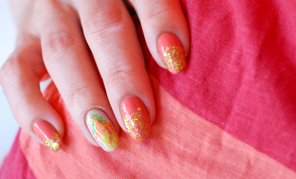 glitter gradient peach nails feather accent