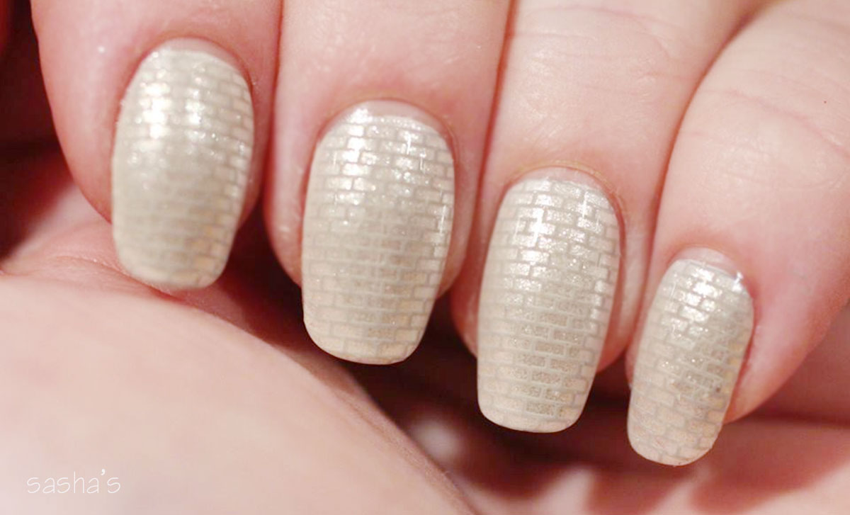 stamped brick wall nails